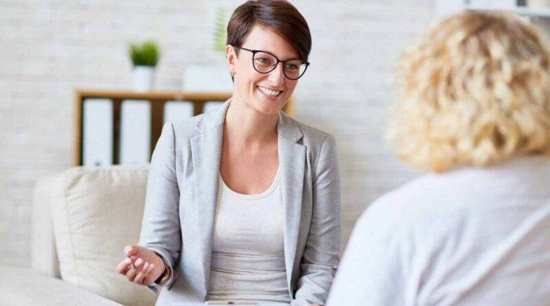 Psychologist smiling and talking with client