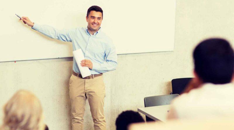 College professor at white board in lecture hall